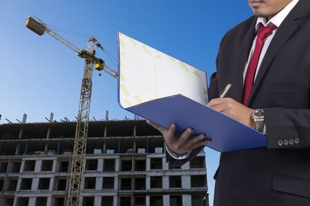 Business, Writing, Note Pad on Construction background Stock Photo