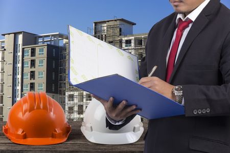 indenture: Business, Writing, Note Pad on Construction background Stock Photo