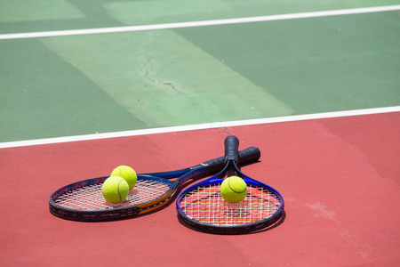 tennis racket and balls on the tennis court photo