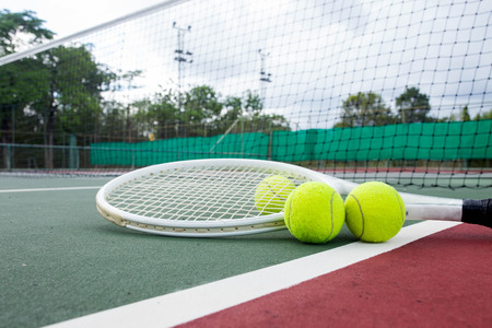 tennis clay: Close up view of tennis racket and balls on the tennis court Stock Photo