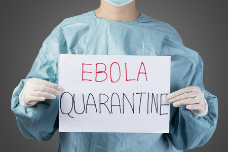 quarantine: scientist in safety suit drawing word ebola quarantine