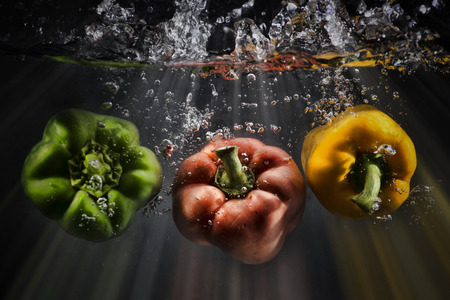 vegetables splash water on black background