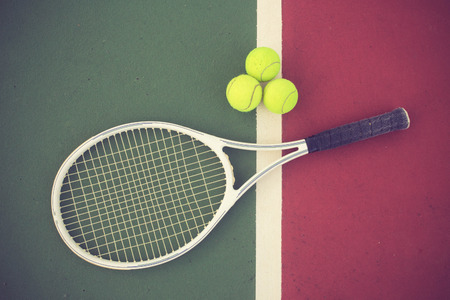 tennis clay: tennis racket and balls on the tennis court vintage color