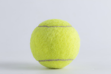 to play ball: tennis ball isolated on white background Stock Photo