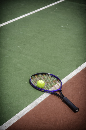 avocation: tennis racket and balls on the tennis court