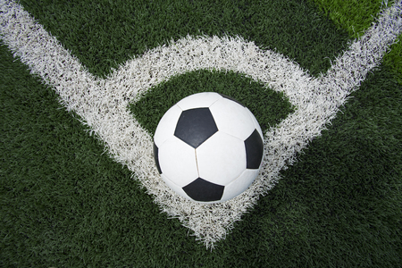 soccer grass: soccer ball or football on soccer field Stock Photo