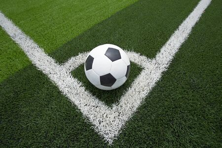 ballsport: soccer ball or football on soccer field Stock Photo