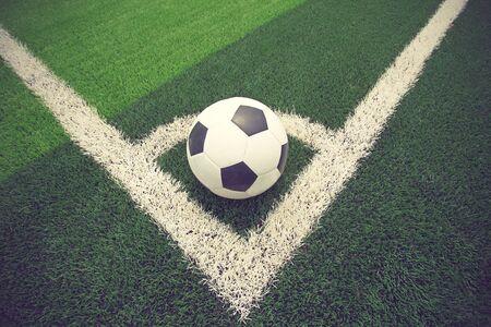 ballsport: soccer ball or football on soccer field vintage color Stock Photo