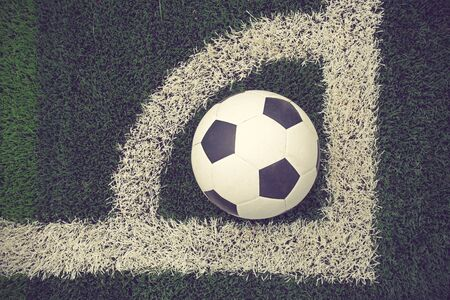 ballsport: soccer ball on soccer field vintage color