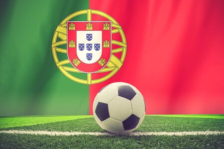 footwork: soccer ball in front of the Portugal flag vintage color