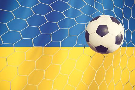 ukraine flag: Soccer Background with Ukraine Flag vintage color