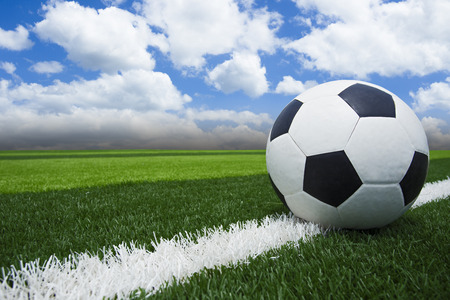 Soccer blue sky/ Football in the blue sky Standard-Bild