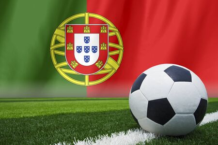 soccer ball in front of the Portugal flag Stock Photo