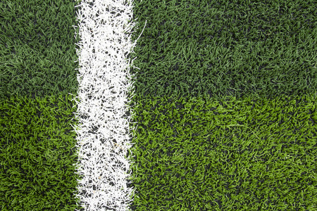 goalline: Photo of a green synthetic grass sports field with white line shot Stock Photo