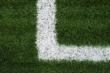 sports field: Photo of a green synthetic grass sports field with white line shot Stock Photo