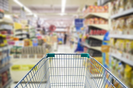 local supply: shopping cart in supermarket Stock Photo