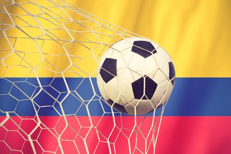 banderas america: balón de fútbol en colombia color de la bandera de la vendimia Foto de archivo