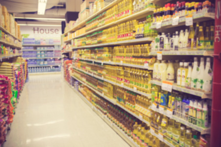 supermarket in blurry for background vintage color Banco de Imagens