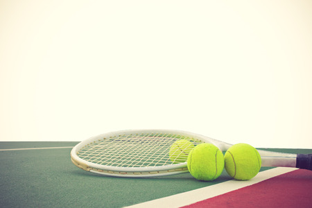 tennis clay: tennis racket and balls on white background vintage color