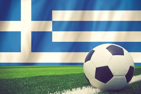 footbal: Soccer ball on Greek grunge flag vintage color
