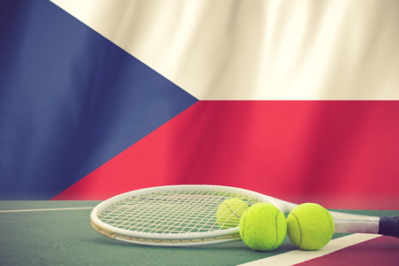 Tennis ball in net on CZECH flag background.vintage color