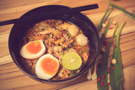 thai noodle soup: Thai noodle soup in a bowl taste spicy noodle soup and boiled egg vintage color