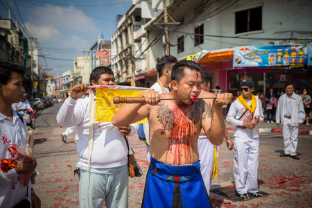 possess: Nakhon Ratchasima, THAILAND - OCT 16: An unidentified devotee of Vegetarian Festival, person who invites the spirits of gods to possess their bodies on October 16, 2015 in Nakhon Ratchasima, Thailand