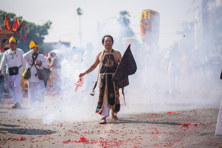 devotee: Nakhon Ratchasima, THAILAND - OCT 16: An unidentified devotee of Vegetarian Festival, person who invites the spirits of gods to possess their bodies on October 16, 2015 in Nakhon Ratchasima, Thailand
