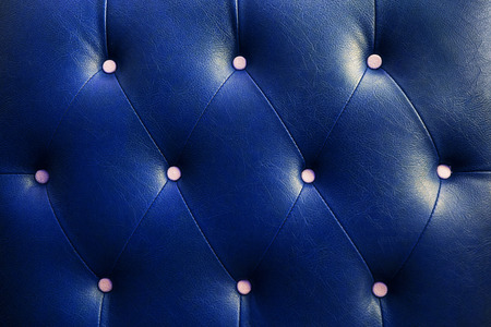 buttoned: Buttoned on the blue Texture Stock Photo