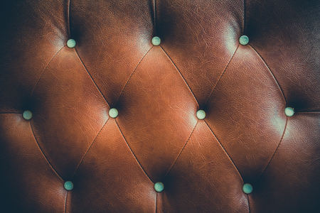 chambered: Genuine leather upholstery background for a luxury decoration in Brown tones vintage color Stock Photo