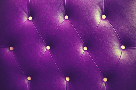 chambered: Genuine leather upholstery background for a luxury decoration in purple tones vintage color