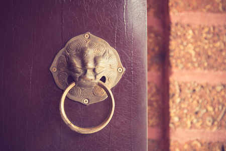 constitute: Ancient Chinese door knocker, located in Temple vintage color