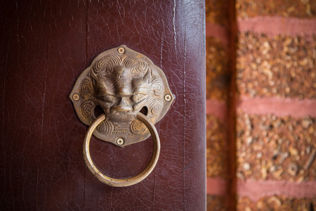 constitute: Ancient Chinese door knocker, located in Temple Stock Photo