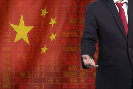 Flag of China. Downtrend stock data diagram with business man with empty hand Stock Photo