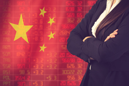 Flag of China. Downtrend stock data diagram with business woman vintage color Stock Photo
