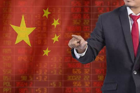 sell shares: Flag of China. Downtrend stock data diagram with Business man pushing on a touch screen interface analyze solution ideas concept design Stock Photo