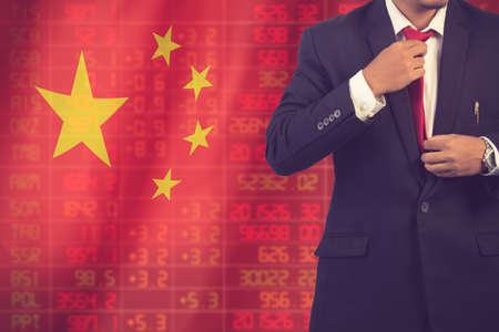 Flag of China. Downtrend stock data diagram with business man vintage color Stock Photo