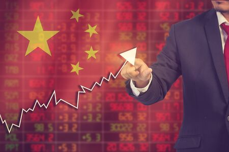 Flag of China. Downtrend stock data diagram with Business man pushing on a touch screen interface analyze solution ideas concept design vintage color