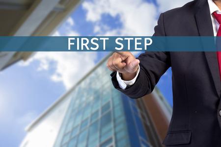 tab: Businessman hand touching FIRST STEP tab on virtual screen Stock Photo