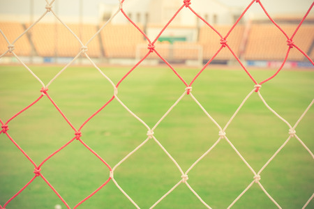 goal net: blurry football and soccer goal net pattern vintage color Stock Photo