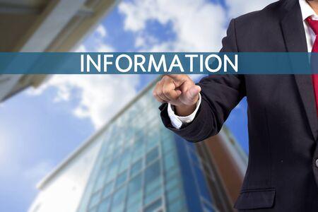 tab: Businessman hand touching INFORMATION tab on virtual screen