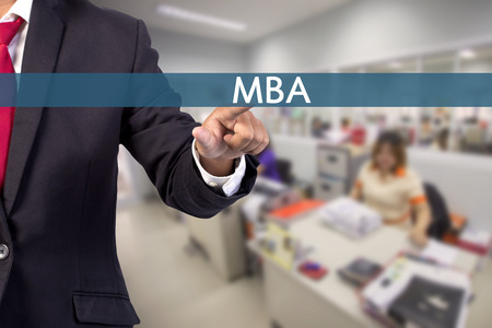 master degree: Businessman hand touching MBA (or Master of Business Administration) sign on virtual screen Stock Photo