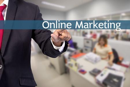 tab: Businessman hand touching ONLINE MARKETING tab on virtual screen Stock Photo