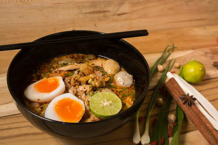 instant ramen: bowl of noodles with vegetables and soft boiled egg on wooden table. delicious noodle. Instant noodle. hot noodle.Homemade Quick Ramen Noodles with egg.