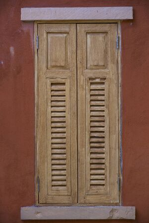 architech: vintage windows on the red wall Stock Photo