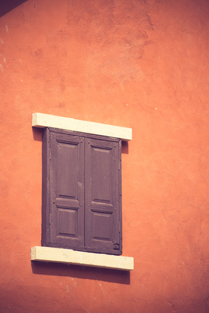 architech: vintage windows on the red wall vintage color Stock Photo