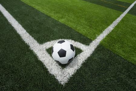 ballsport: soccer ball or football on soccer field Stock Photo