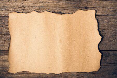 old paper on brown aged wood.Vintage color