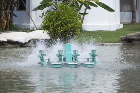 paddle wheel: Aerator turbine wheel fill oxygen into water in lake Stock Photo