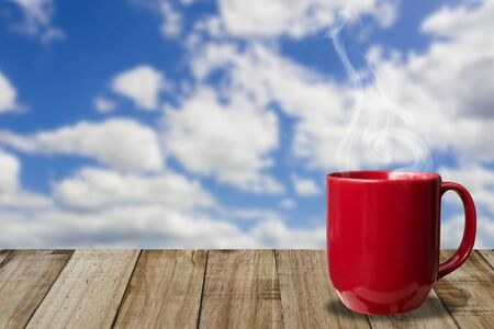 puffy: Morning coffee cup with beautiful blue sky and puffy clouds background Stock Photo